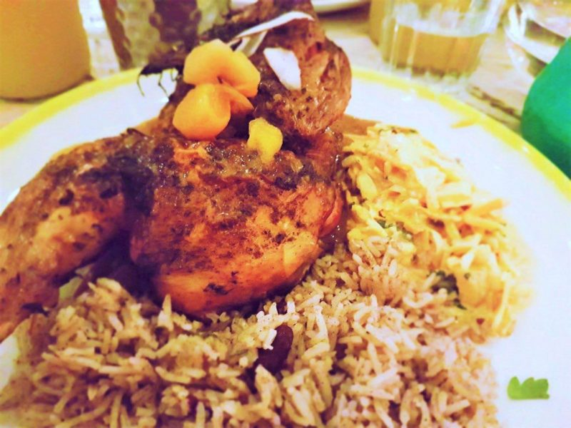 24 hours Jerk marinated pit grilled half chicken with coconut rice n peas and caribbean slaw from Turtle Bay