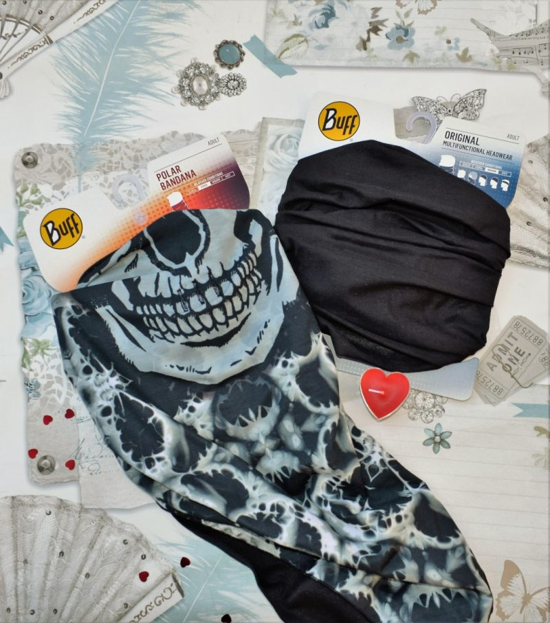 2x Buff Neckwear pieces one plain black and the other Skull
