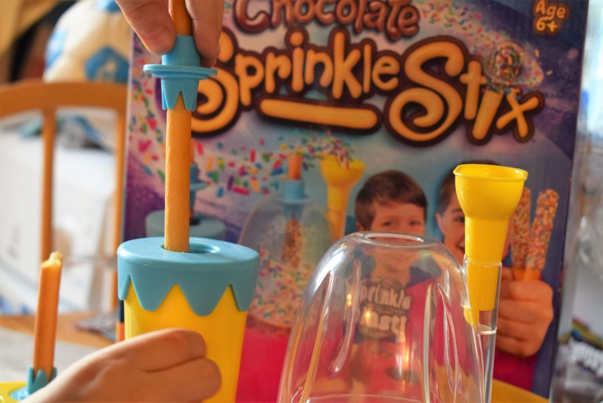 Dunking the breadstick into chocolate - Chocolate Sprinkle Stix